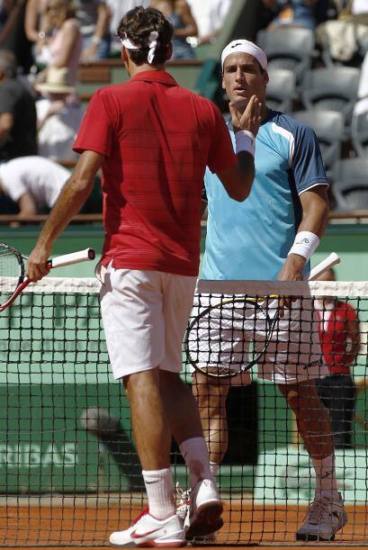 El duelo estelar del día se dio entre el suizo Roger Federer (fot...