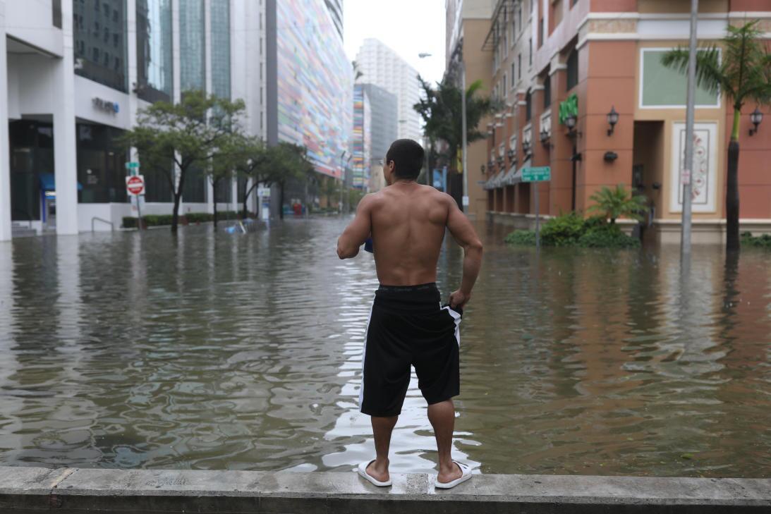 Vishnu Obregon, a Miami resident, looks down a street in the Brickell fi...