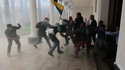 In photos: A pro-government group burst into Venezuela's National Assembly