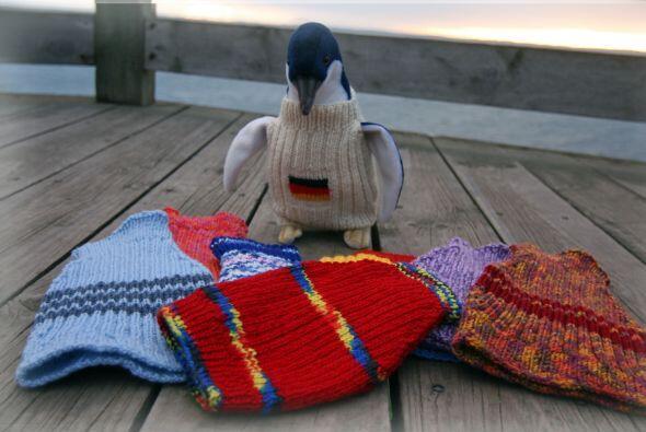 Estos pequeños suéteres tejidos cubren todo el cuerpo del...