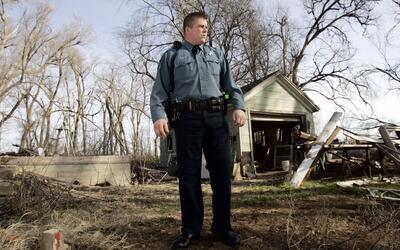 Un policía en zonas rurales de Kansas, donde buscan este tipo de...