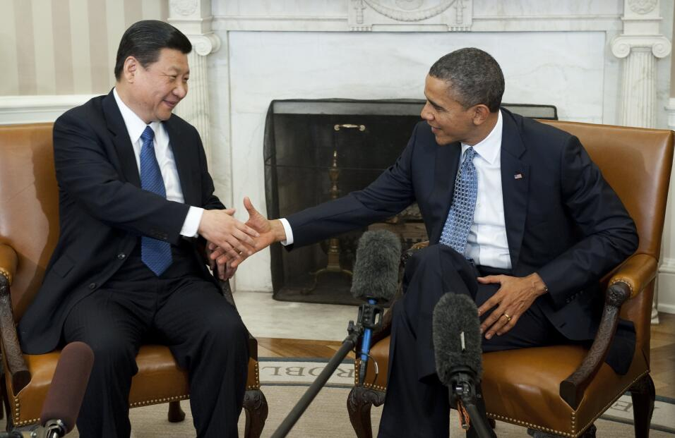 US President Barack Obama shakes hands with Chinese Vice President Xi Ji...