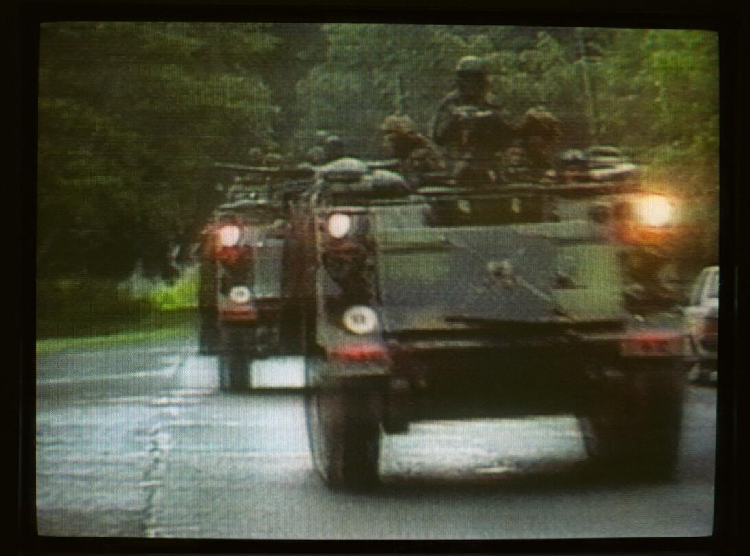 US troops move through Panama City early December 20, 1989 after Preside...