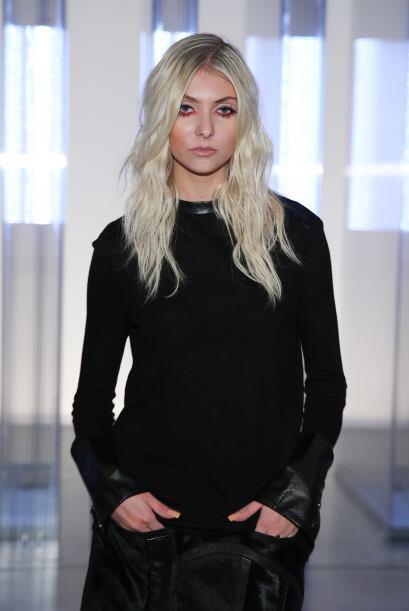 En un evento de moda en septiembre de 2013, con su acostumbrado negro. Y...