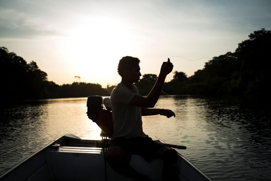 Henriques P. Morois, 20, fishes on the Xingu River. Fishing has sustaine...