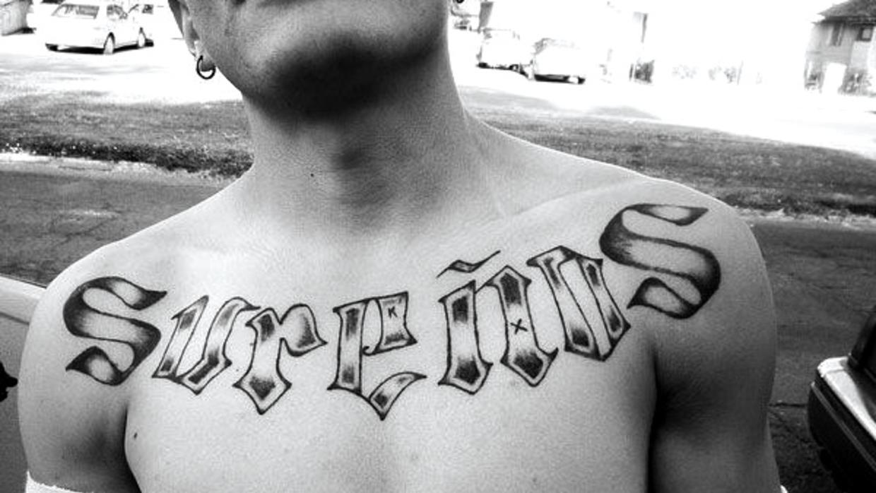 Members of a gang in Southern California wear tattoos with the word &quo...
