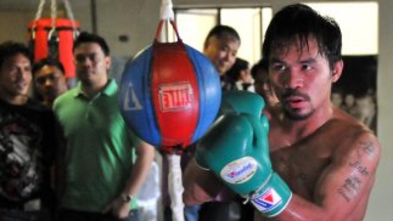 Manny Pacquiao se prepara en el 'Widcard Gym' para defender su título we...