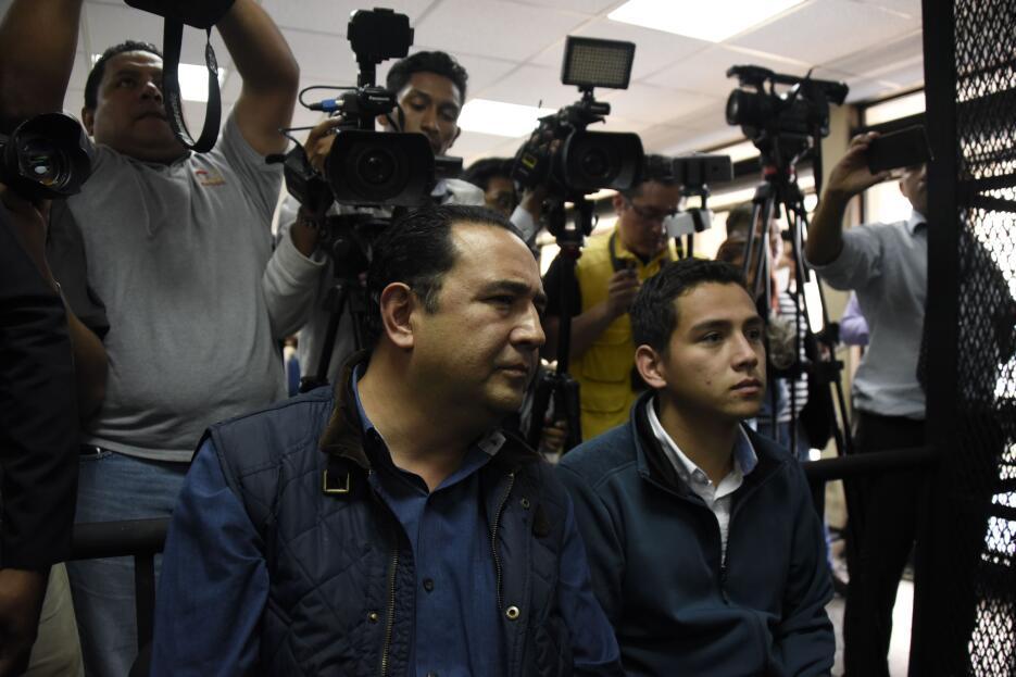 El hijo del presidente, José Manuel Morales (D), y su tío, Sammy Morales...