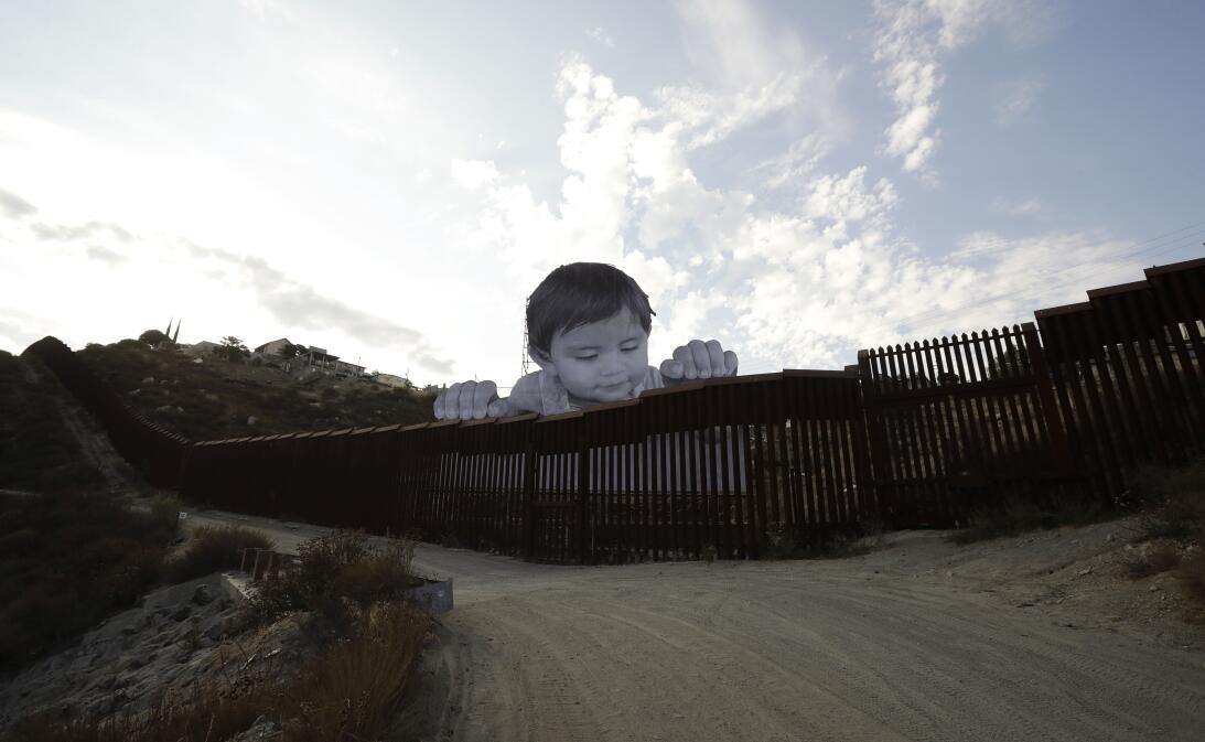 What is this curious child thinking as he peers over the border wall? EE...
