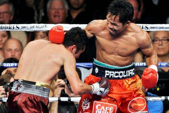 """""""scar De la Hoya y Manny Pacquiao se enfrentaron el 6 de diciembre del 2..."""