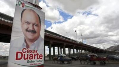 Un cartel con la imagen del exgobernador de Chihuahua, César Duarte.
