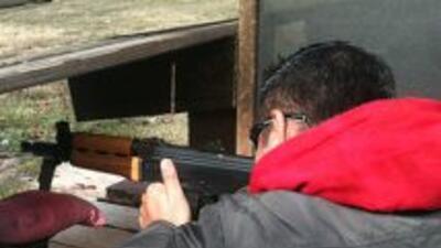 Suiza tiene uno de los índices más altos del mundo de armas en manos de...