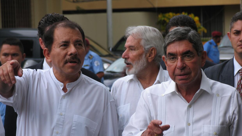 Costa Rican President Oscar Arias and Nicaraguan President Daniel Ortega...