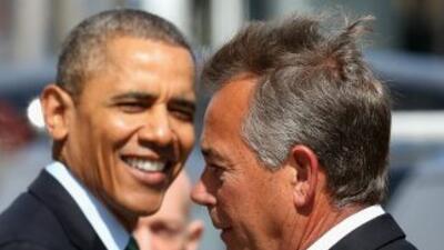 El presidente Barack Obama junto al congresista repubicano, John Boehner...