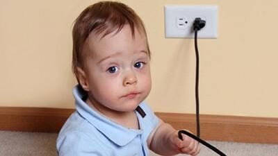 Child and electrical cord.
