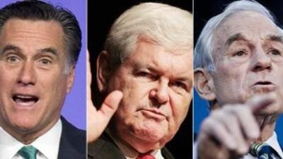 Los aspirantes republicanos Mitt Romney, Newt Gingrich y Ron Paul vuelve...