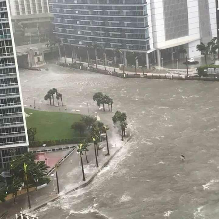 The Miami River overflowing streets in Miami's downtown after the ar...