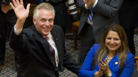 Elizabeth Guzman with Virginia governor Terry McAuliffe in the state cap...