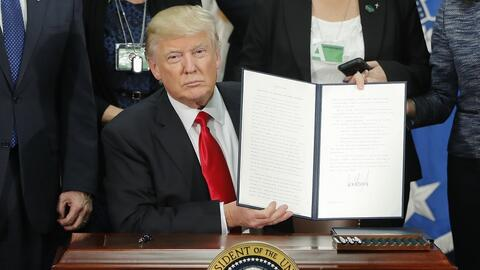 Donald Trump signing executive orders to build wall and increase border...