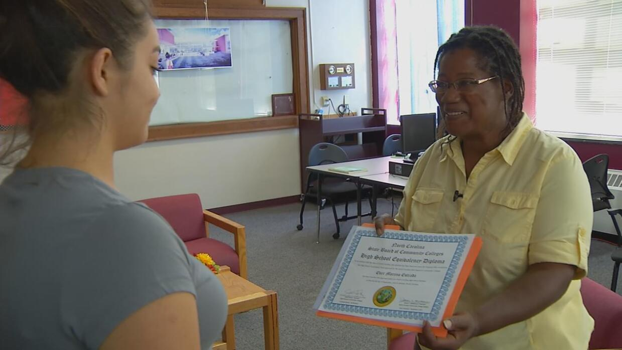 Ever Moreno receives the High School Equivalency Diploma that will allow...