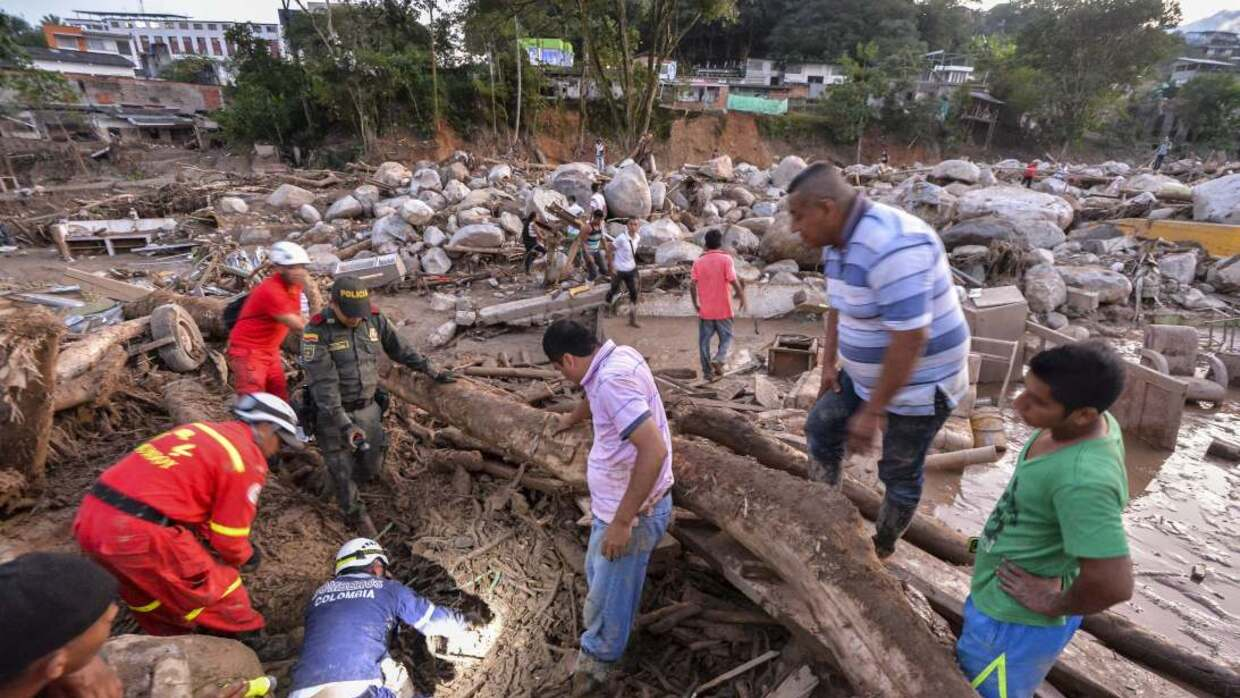 Search-and-rescue teams combed through the debris and helped people who...