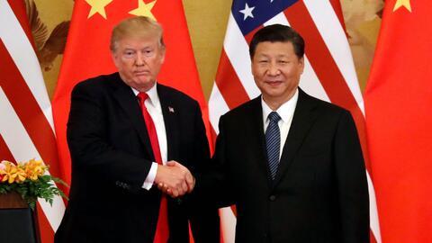 Apretón de manos entre los presidentes Donald Trump y Xi Jiping