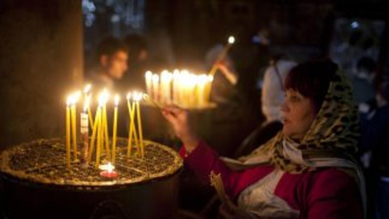 Miles de palestinos cristianos y peregrinos procedentes de todo el mundo...