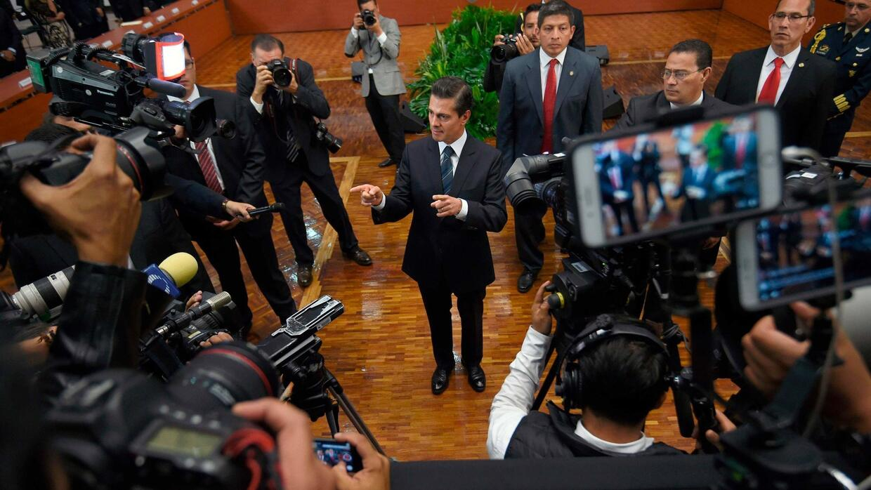 President Enrique Peña Nieto, center, vowed last month to take concrete...