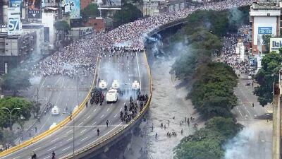 In photos: Police and protesters clash in Venezuela