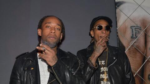 Rappers Ty Dolla $ign and Wiz Khalifa pose for a photo at a listening pa...