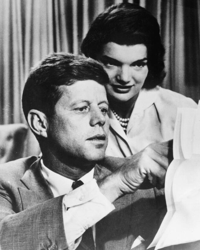 A photo dated 1950's shows John F. Kennedy with his wife Jacqueline...