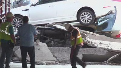 Residentes de Irving logran recuperar sus vehículos del estacionamiento colapsado