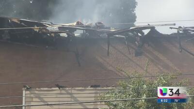 Mujer embarazada se lanza por un balcón de un edificio en llamas