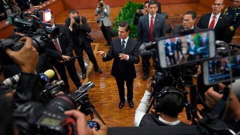 President Enrique Peña Nieto, center, vowed last month to take co...
