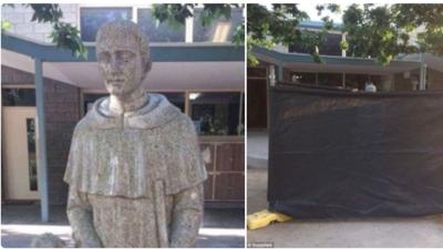 Una estatua de San Martín de Porres que le ofrece un pan a un ni&...