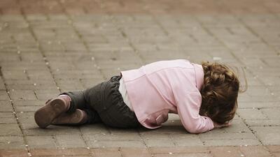 Upset kid on floor