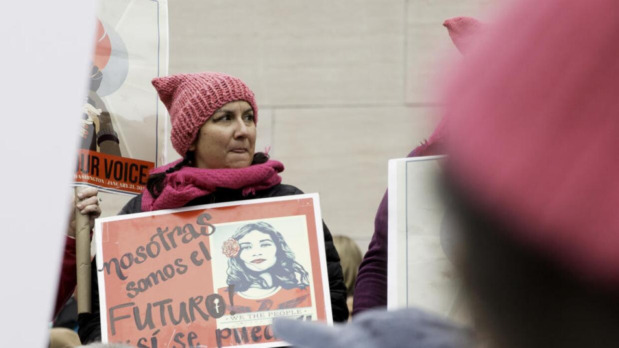 """We are the future,"" reads a sign in Spanish at the Women'..."