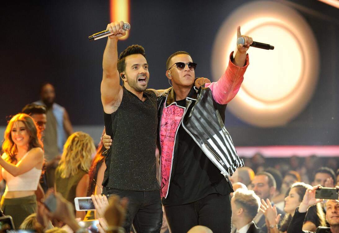Luis Fonsi and Daddy Yankee perform onstage at the Billboard Latin Music...