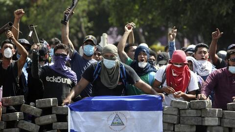 Anti-government protesters nam a barricade in Managua, Nicaragua, April...