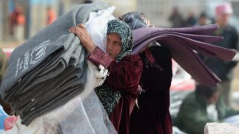 La ONU estima que más de 4 millones de sirios se han visto obligados a b...