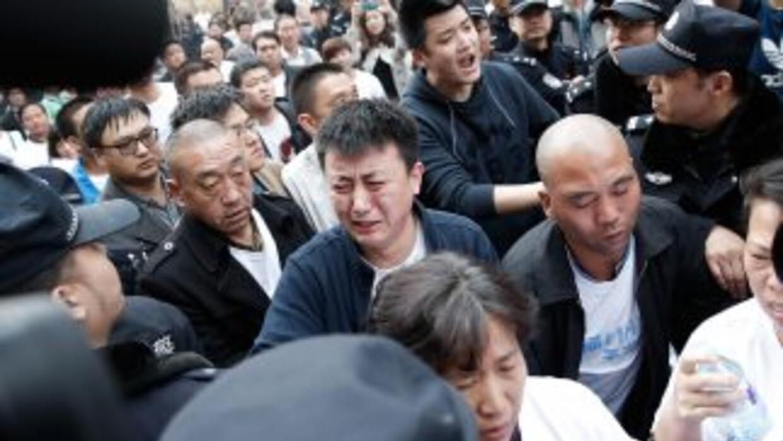 Aseguradoras chinas empezaron a pagar a las familias de los pasajeros de...