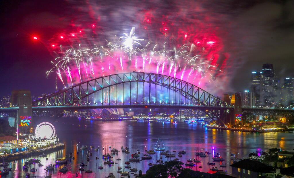 - JANUARY 01: Fireworks explode from the Sydney Harbour Bridge and the...