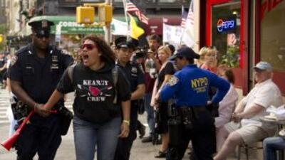 Nueva York vivió este sábado el aniversario más politizado y controverti...