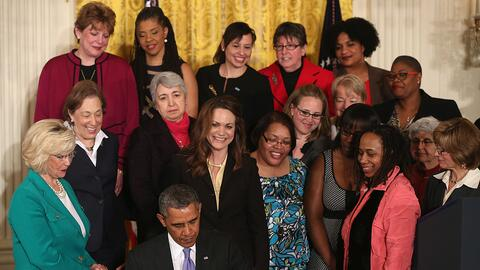 President Obama signing an executive order on equal pay laws for women