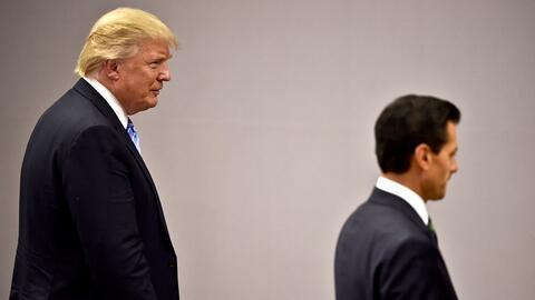 US presidential candidate Donald Trump follows Mexican President Enrique...