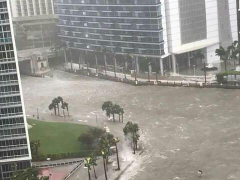 The Miami River overflowing streets in Miami's downtown after the arriva...