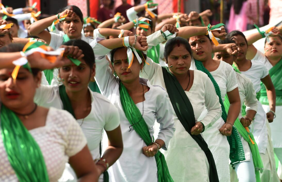 Indian women perform a demonstration in self-defense during an event in...