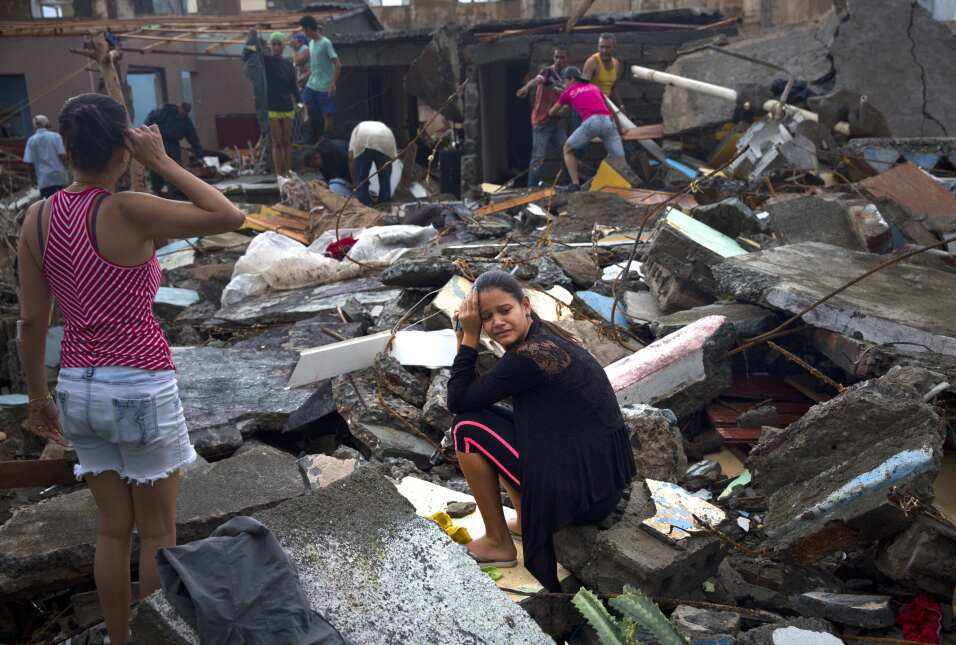 A woman cries in the ruins of her house after the passage of Hurricane M...