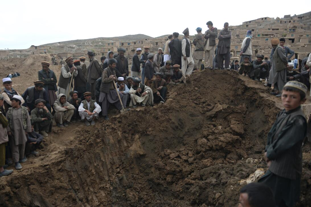 Afghan rescuers search desperately for survivors trapped under the mud i...