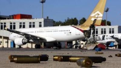 Un total de 11 aviones comerciales de Libyan Airlines y Afriqiyah Airway...